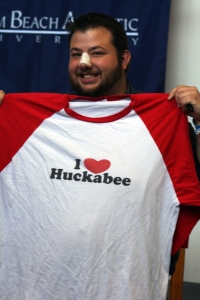 "Tyler Schlichter holding up his ""I heart Huckabee"" t-shirt"
